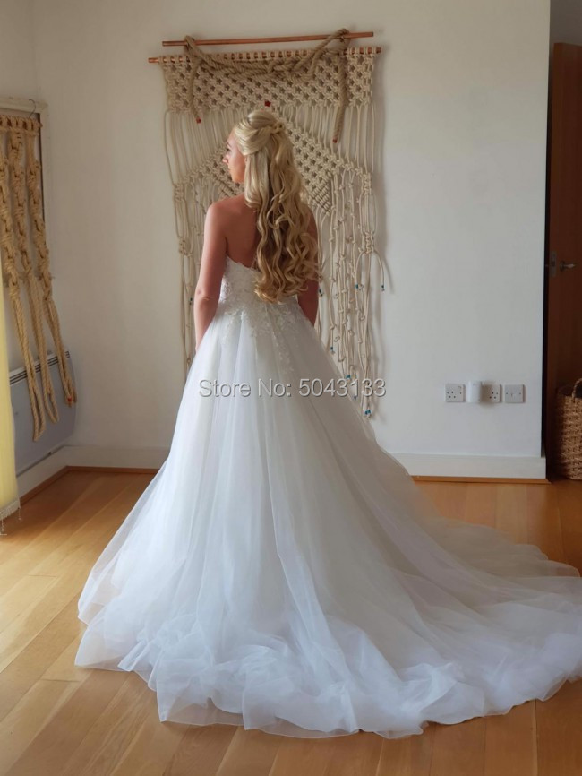 Image 2 - A Line Tulle Wedding Dresses 2020 Exquisite Lace Appliques Sweetheart Off the Shoulder Bridal Gowns Long Backless Robe De Marrie-in Wedding Dresses from Weddings & Events