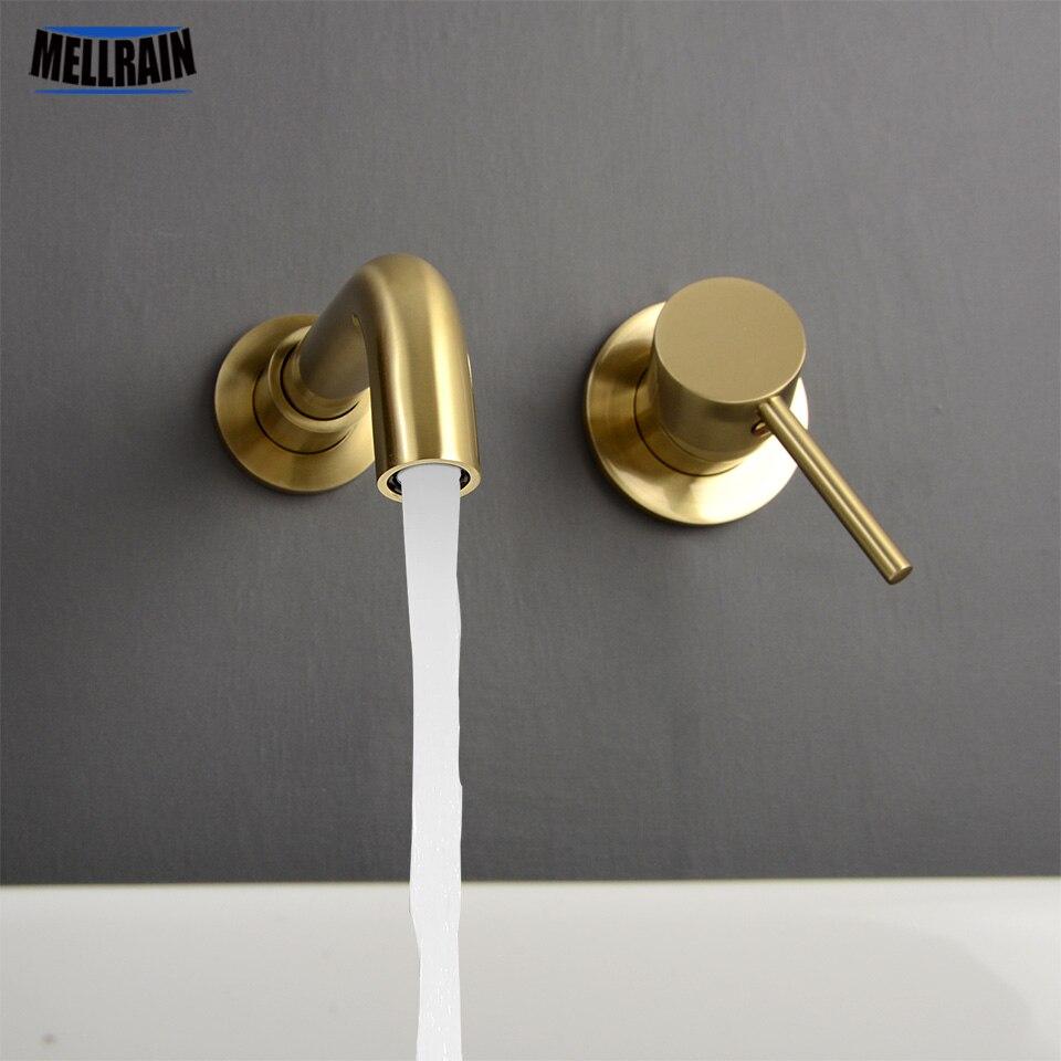 Minimalismo grifo de baño de un solo mango montado en la pared negro y oro cepillado grifo mezclador de agua 360 grados giratorio