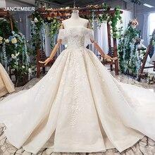 HTL698 แต่งงานกับผ้าคลุมหน้างานแต่งงานลูกปัดเรือคอปิดไหล่งานฝีมือลูกไม้ gowns แต่งงาน 2019 encontrar loja