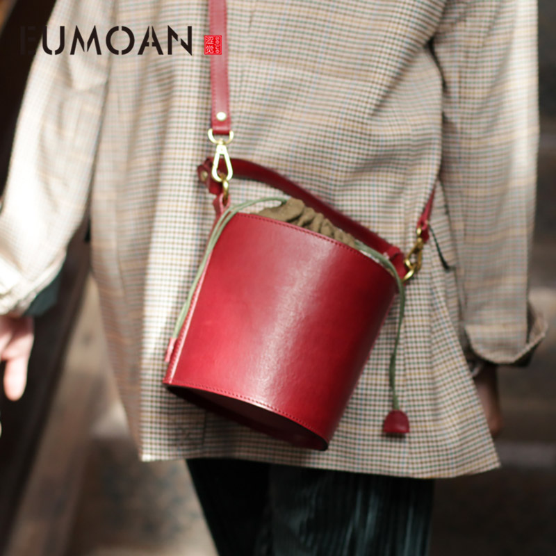 EUMOAN Pumped rope bucket bag, women's handmade small bag, leather retro wind large capacity hundred-sloping bag