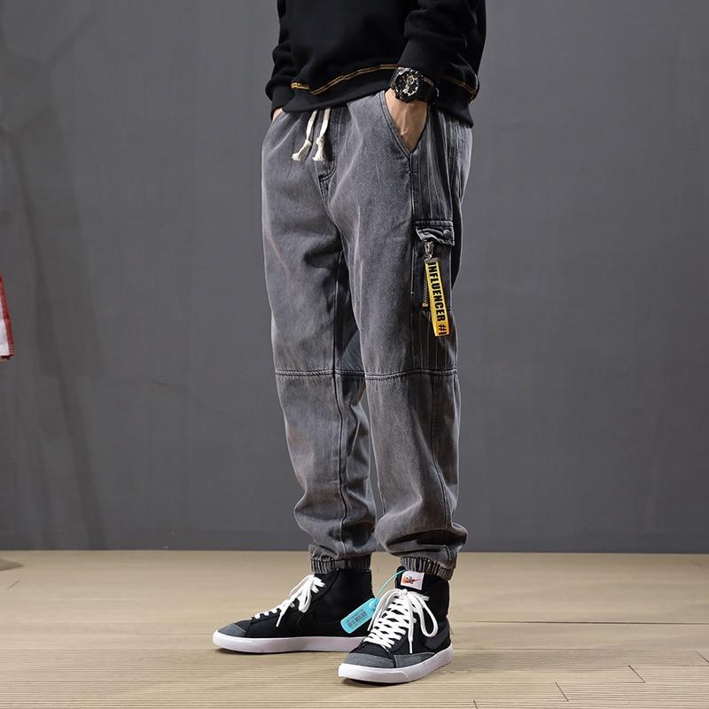 Fashion Streetwear Men Jeans Loose Fit Stripe Designer Patch Pocket Spliced Cargo Pants Harem Jeans Hip Hop Joggers Jeans Men