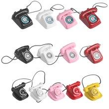 Teléfono en miniatura Retro a escala 1:12, adorno de Metal Vintage para casa de muñecas, juguetes para niños, accesorios para muñecas