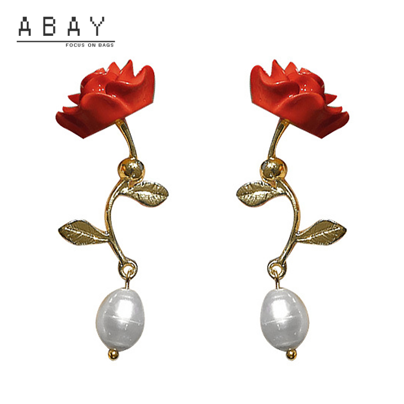 S925 aguja de plata pendiente con flor rosa las mujeres nueva moda de Primavera de viento fresco elegante Retro avanzado sentido pendientes venta al por mayor