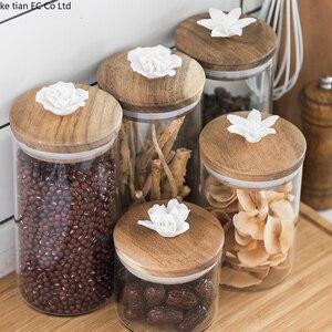 Image 1 - İskandinav yaratıcı seramik çiçek kahve çekirdeği şeker mühürlü kavanoz dekoratif cam kavanoz mutfak büyük saklama kavanozları ahşap kapaklı