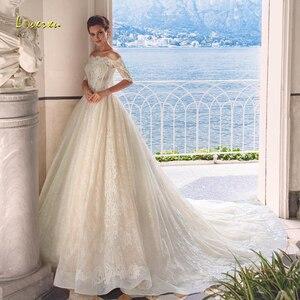 Image 1 - Loverxu Boat Neck A Line Wedding Dresses 2019 Appliques Half Sleeve Button Lace Bride Dresses Chapel Train Bridal Gown Plus Size
