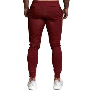 Image 5 - ブランドメンズスポーツランニングパンツ通気性ジョギングパンツスポーツパンツを実行するためのテニスサッカー再生ジムズボンポケット