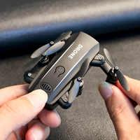 Drone RC quadrirotor Mini Drone caméra HD 1080P Wifi FPV Dron pliable Altitude tenir RC hélicoptère Selfie Drones jouet professionnel