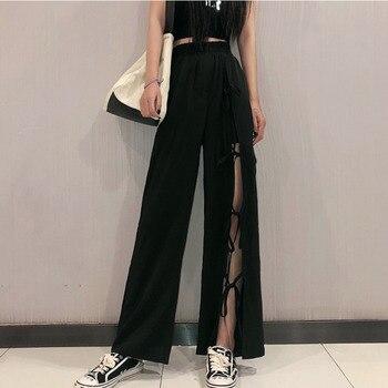 Czarne spodnie z rozcięciem damskie jednolity wysoki elastyczny wyszczuplająca talia spodnie z kieszenią 2020 jesień gorąca, seksowna Hollow Out Strip szerokie spodnie nogi