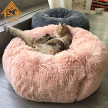 Sleeping bed for dogs for a wrap-up loving warmth.