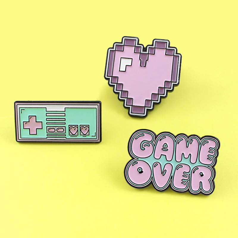 Cartoon Heart Pink Purple Pixel Gamepad Brooches GAME OVER !Brooch Enamel Pins Shirt Lapel Pin for Friends Female Male Badge(China)