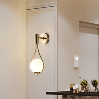 Postmodern living room background wall iron minimalist personality hotel aisle bedroom bedside glass ball wall lamp led lamp