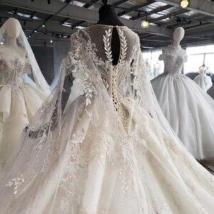 Image 4 - HTL1004 בציר חתונה שמלה עם גלימה אשליה o צוואר שרוול צעיף תחרה עד בחזרה חרוזים הכלה שמלות כלה יוקרה חלוק mariee