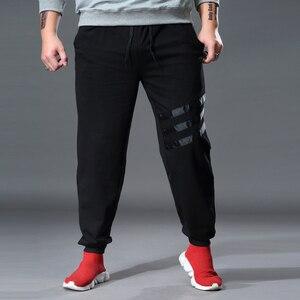 Image 2 - Homme survêtement pantalon Sweat Joggers ample élastique Stretch grande taille grand 6XL 7XL Broek Mannen pantalons de survêtement sport Hombre vêtements pour hommes