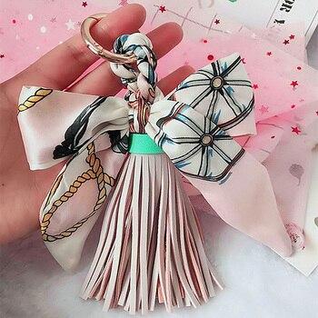 Skórzany brelok do kluczy z pomponem brelok na prezent dla kobiet dziewczyn torba wisiorek muszka Charms breloczki biżuteria Porte klucz wiolinowy