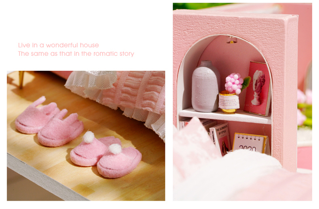 bedroom contents of the pink doll house. slippers and a bed side cabinet