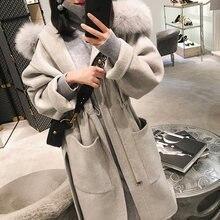 Женское шерстяное пальто с капюшоном и воротником из лисьего
