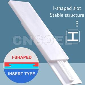 Image 4 - 1Pcs I shaped Insert Type Socket Fixer Removable Self adhesive Wall Hanging Type Home Improvement Supplies Socket Fix sticke