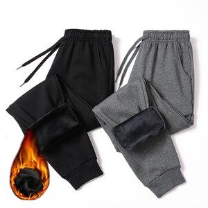 Image 2 - شتاء دافئ القطن Sweatpants الرجال الشارع الشهير السراويل قلم رصاص غير رسمي الكتان الرجال السراويل كامل طول الرباط بنطلون للرجال 4XL