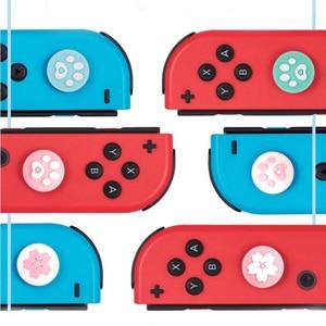 Image 3 - Carino Zampa di Gatto Artiglio Sakura Thumb Stick Grip Cappuccio Joystick Copertura Per Nintend Interruttore Lite Joy Con Controller Gamepad thumbstick Caso