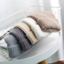 Hat women autumn and winter solid color imitation hair wool wild knit pompom hat warm fashion earmuf