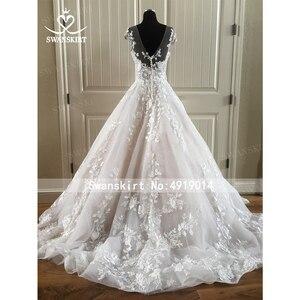 Image 5 - אופנה אפליקציות חתונת שמלת Swanskirt N131 מתוקה אונליין גב פתוח נסיכת כלה שמלת משפט רכבת vestido דה noiva