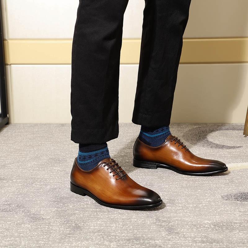 wholecut black shoes