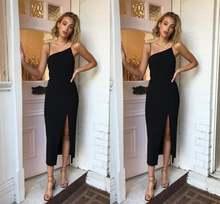 Женское вечернее платье на бретельках черное с разрезом для