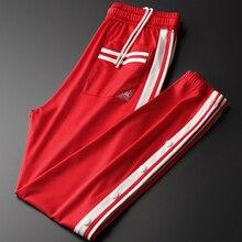 Minglu kırmızı erkek pantolon lüks ilkbahar ve sonbahar şerit kenar erkekler pantolon artı boyutu 3XL 4XL elastik bel Slim Fit spor pantolonları erkek