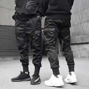 Image 2 - Moda uomo Multi Tasca Harem Pants Hip Hop Pant Nastri Pantaloni di Strada Harajuku Sweatpant Maschio Casual Tactical Cargo Pant