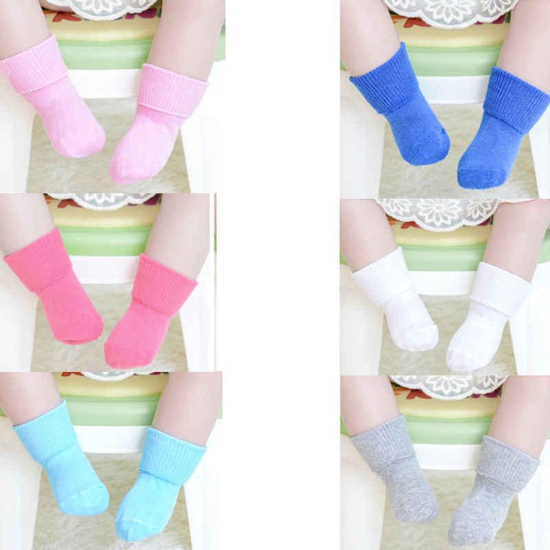 2019 nuevo bebé recién nacido niños bebés niñas calcetines calientes Calcetines antideslizantes de algodón invierno Color caramelo sólido calcetines infantiles 0-6T