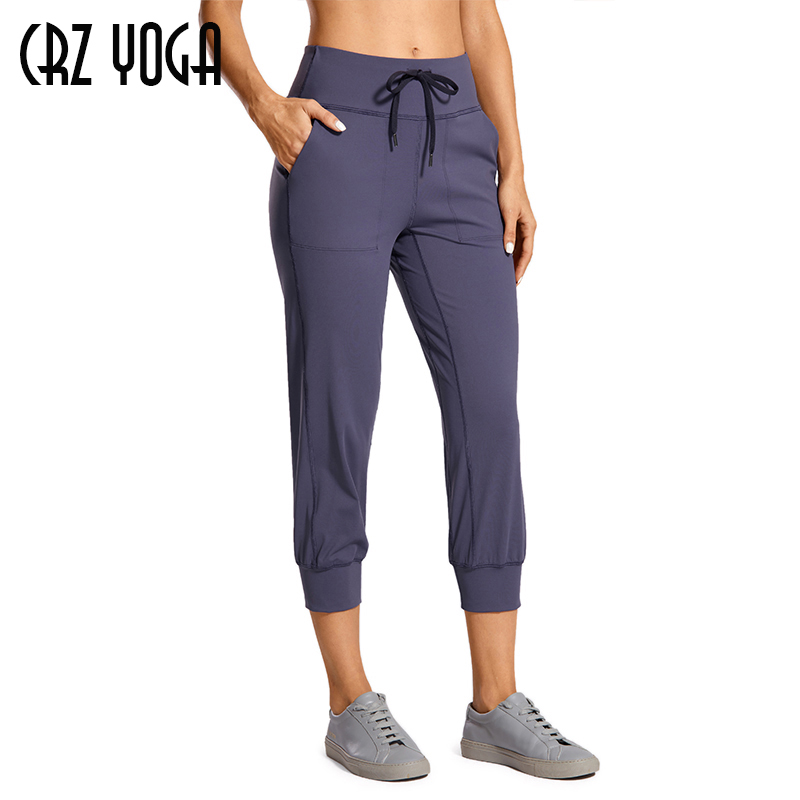 CRZ YOGA Women's Naked Feeling Workout Yoga Jogger with Pockets Drawstring Comfy Lounge Capri Pants