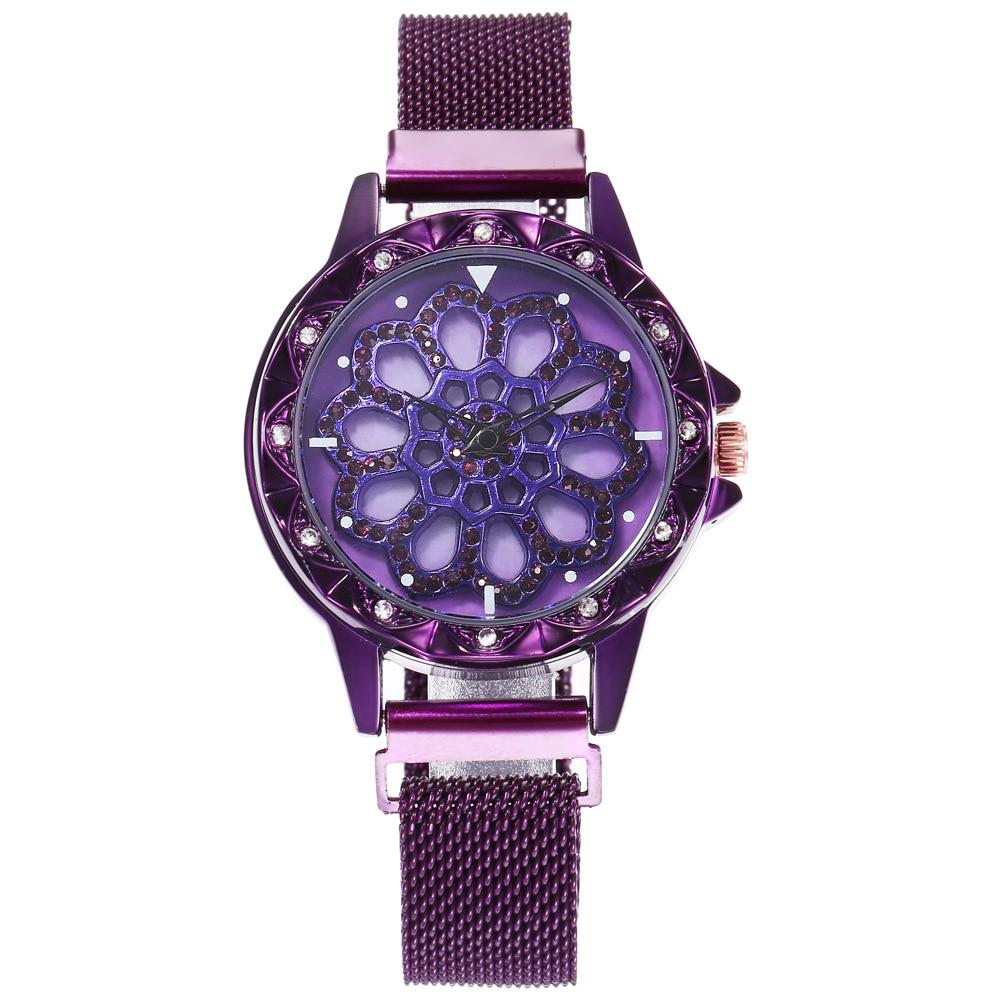 Montre à bracelet aimanté et à cadran tournant  violette