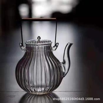 Trzymając garnek żaroodporny szklany imbryk głowica dźwigu ze wzorem chryzantemy zupa wrzący zestaw do herbaty kung fu ceremonia herbaty miedziany uchwyt tanie i dobre opinie
