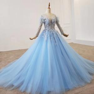 Image 2 - HTL1203 סיום כחול שמלת o צוואר ארוך שרוול נוצת על כתף ומותנים אור טול חצאית שמלת ערב платье выпускное