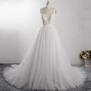 Image 1 - LZ400 Shiny Parels Kleine Bloemen Trouwjurk V hals Mouwloos A lijn Bridal Jurk Met Sluier Vestido De Noiva