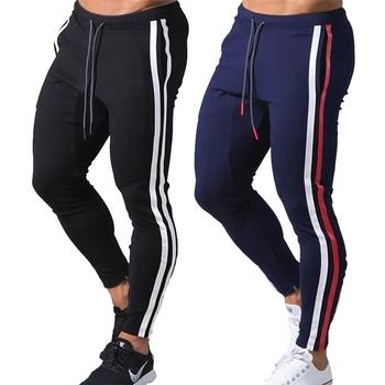 Streetwear spodnie do joggingu męskie spodnie sportowe spodnie do joggingu męskie spodnie do joggingu bawełniane spodnie sportowe dopasowane obcisłe spodnie spodnie do fitnessu tanie i dobre opinie GEHT Ołówek spodnie CN (pochodzenie) Pełnej długości Mieszkanie REGULAR COTTON Poliester 2 55 - 3 08 Midweight Suknem