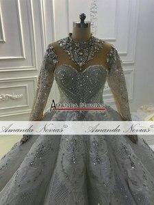 Image 5 - トップ高級ヘビービーズウェディングドレス黒花嫁デザインのウェディングドレスブライダルメイクアップ 2020