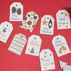 Image 4 - 100 adet/grup beyaz noel kağıt etiketleri bagaj düğün not boş fiyat etiketi asın Merry Christmas hediye kartı halat 6.8*4.5cm