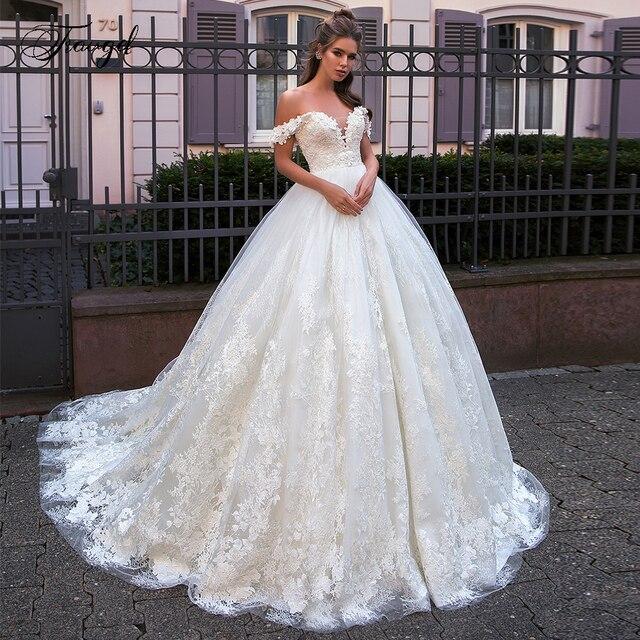 Traugel حبيب A خط الدانتيل فساتين الزفاف زين قبالة الكتف بلا ظهر فستان عروس ذيل محكمة فستان زفاف حجم كبير