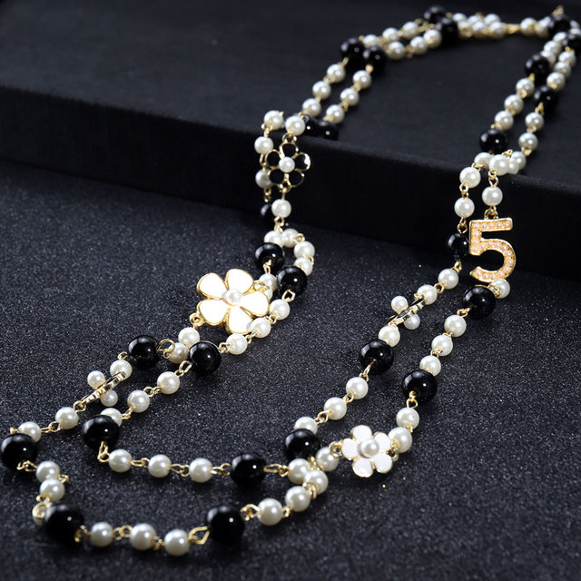 layered pearl and number pendant necklace 5