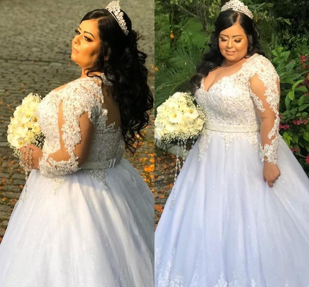 Plus Size Illusion Long Sleeve Wedding Dresses 2020 Sparkly Lace Beaded Sheer Jewel Neck Country Garden Bride Dress Gowns