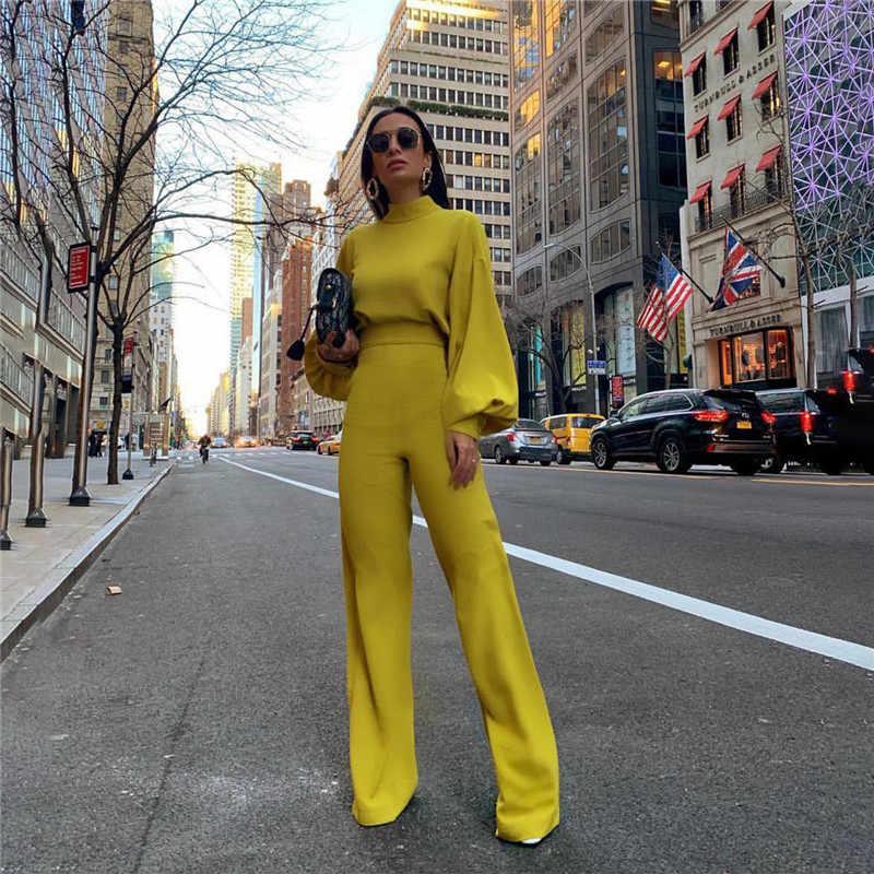 คอเต่าแขนยาวผู้หญิงหลวม Jumpsuit เสื้อกว้างขากางเกง Elegant Overalls สีเหลืองสีขาวสีดำ Combinaison Femme