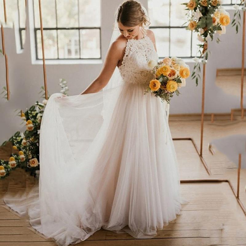 High End Beach Wedding Dresses 2020 Court Train Tulle Halter Custom Made Illusion Bridal Gowns