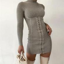 Элегантное осенне зимнее вязанное женское мини платье в рубчик