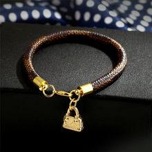 Modyle nova moda ouro cor couro genuíno mulheres homem pulseiras saco encantos pingente pulseiras jóias