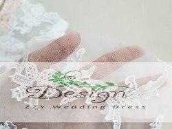 Accessoires de mariage motifs de dentelle hors épaule veste en dentelle pour mariage cristaux romantriques Appliques veste de mariage