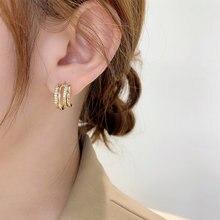 Женские серьги гвоздики золотого цвета с кристаллами