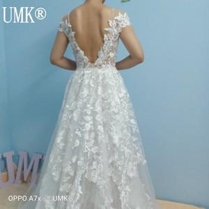 Image 2 - UMK High end Lace Mermaid Wedding Dress 2020 Sexy Backless Short Sleeve Detachable Train Wedding Gowns