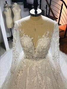 Image 3 - فستان عروس من Liyuke بأكمام طويلة لحفلات الزفاف مع دانتيل رائع من قطار مصلى