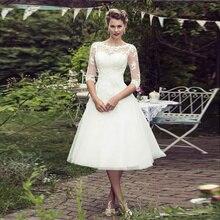 2021 New Lace Round Neck Princess Short Sleeve Wedding Dress Elegant Off White Belt Retro Sexy